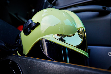 helmet seat: close-up picture of a white fire helmet on car seat Stock Photo