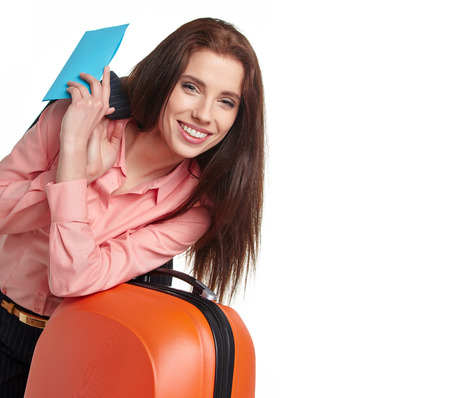 businesswoman with a suitcase and a ticket on a white background photo