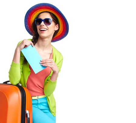 boarding: portrait of female tourist with travel suitcase and boarding pass