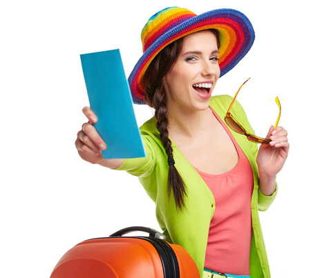 boarding: Portrait of female tourist with travel suitcase and blue boarding pass, isolated on white