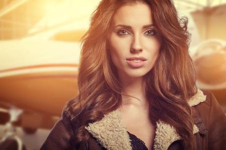 aviator: Portrait of beautiful woman aviator in airport Stock Photo