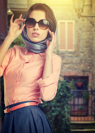 Fashionable woman on the streets of a small Italian town photo