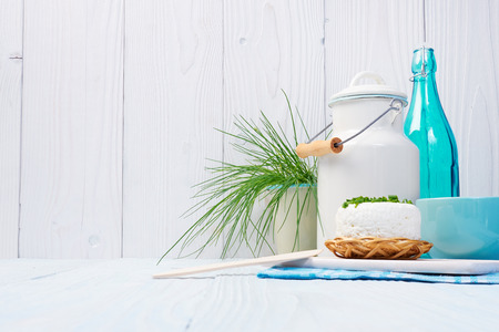 dairying: Chives, milk jug and cottage chease Stock Photo