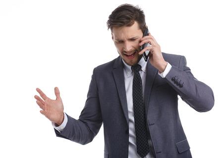 telephone salesman: Businessman nervously talking on the phone