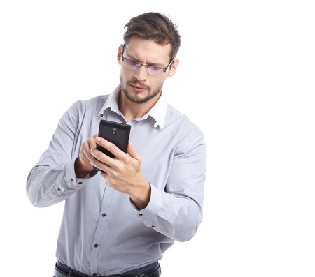 bristly: Young man using a mobile phone. Stock Photo