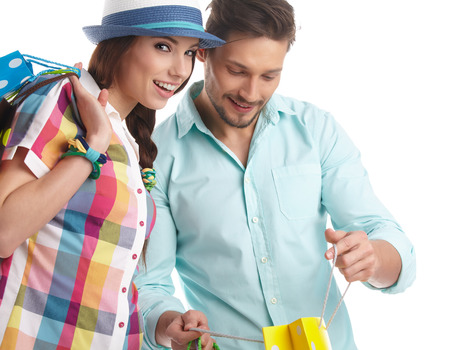 Young, smiling couple on a shopping spree. Shallow DOF, focus on womans eye.
