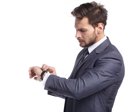young business man  looking at watch over white background Stock Photo