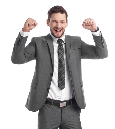 energetic people: Portrait of a energetic young business man enjoying success, screaming against white - Isolated