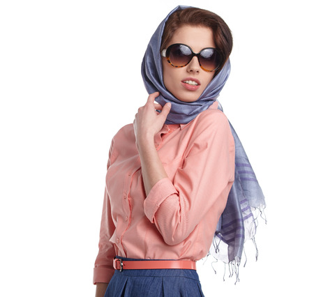 Fashion woman in sunglasses and scarf. studio shot photo