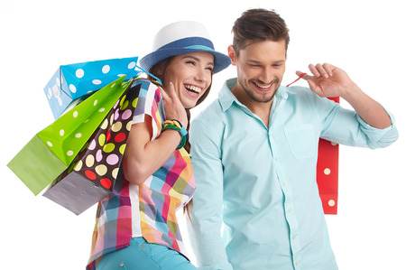 Couple with shopping bags. Studio Stock fotó