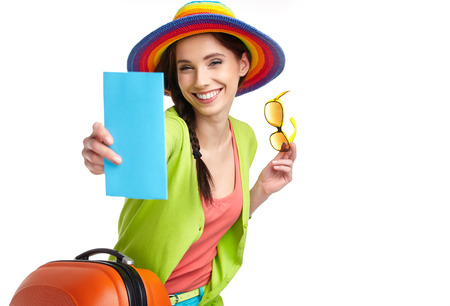 pass on: Woman tourist with travel suitcase and blue boarding pass, isolated on white  background