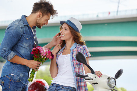 love couple: Portrait of romantic man giving flowers to woman Stock Photo