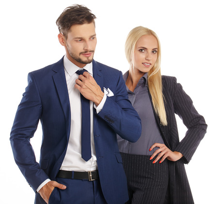 manager team: Young smiling business woman and business man isolated over white background