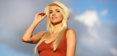 sexy fashion: Beautiful young blond woman outdoors portrait