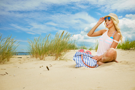 blonde bikini: long blonde haired girl in bikini on  beach