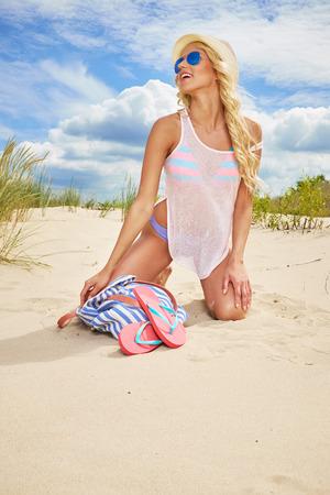 blonde haired: long blonde haired girl in bikini on  beach