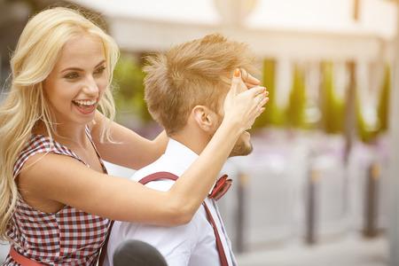 boyfriends: romantic woman covering her boyfriends eyes Stock Photo