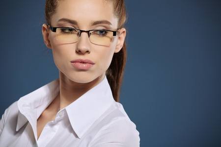 pretty face: Cute young business woman with glasses Stock Photo