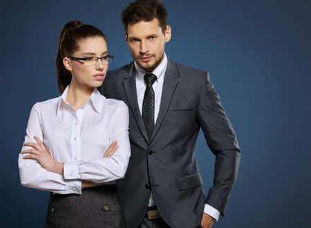 young couple smiling: Business couple on blue background Stock Photo