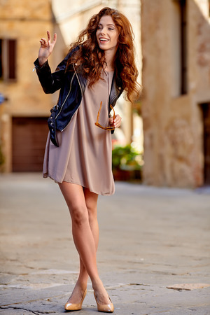 italy street: Beautiful fashion woman outdoor on the street of the old Italy town