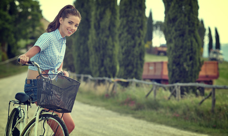 italy landscape: beautiful girl with vintage bike outdoor, summer time