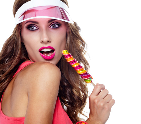 lolita: Glamourous girl wearing plastic cap holding lollipop
