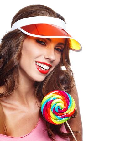 summer beauty: Beauty summer model girl Eating colourful lollipop.
