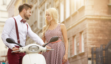 Love couple on the street with retro scooter Stock Photo - 43161902
