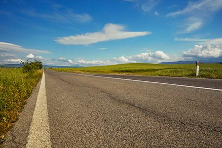 seson: asphalt road in Tuscany hills,  Italy