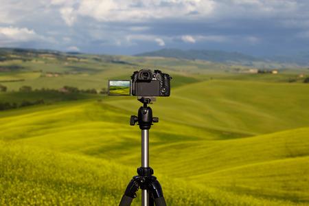 Dslr camera photographing Tuscany hills