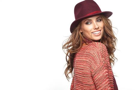 glamour: Beautiful brunette woman portrait in autumn color. Studio shoot