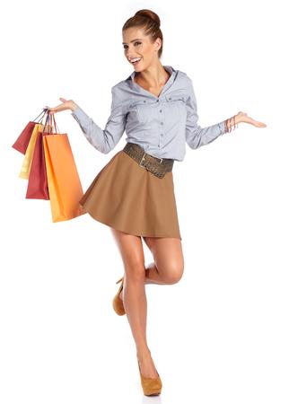 shopping: mujer con bolsas de la compra. Lanzamiento del estudio