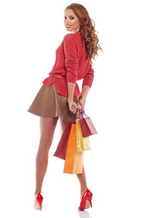 shoping: woman with shoping bags. Studio shoot