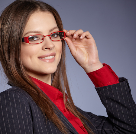 professional woman: Attractive business woman smiling against copy space background