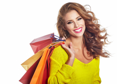 woman in white: Shopping woman holding bags, isolated on white studio background Stock Photo