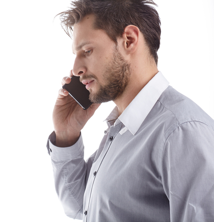 thirty: Cool businessman talking on mobile phone