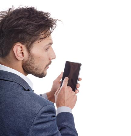 handsome old man: Cool businessman talking on mobile phone