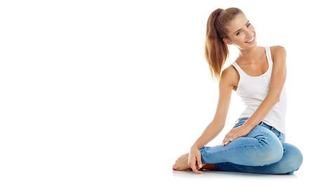 beautiful girl in fashion stylish jeans - isolated on white. Fashion model posing at studio