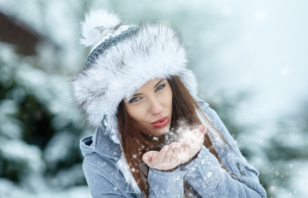 feminine hands: Young woman in winter portrait Stock Photo