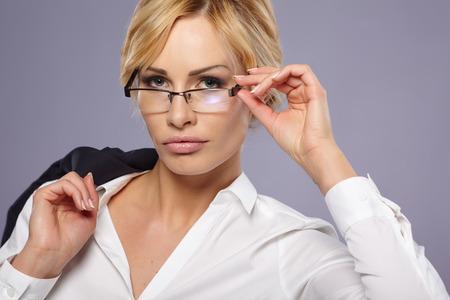 blonde woman: businesswoman in glasses