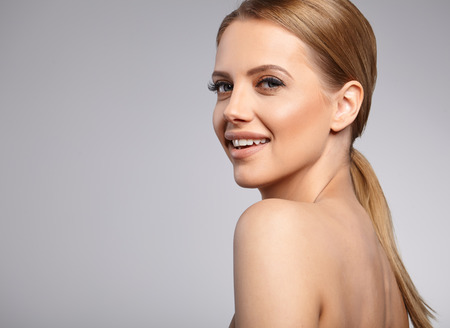 female face: Beautiful Woman with Perfect Fresh Skin. Stock Photo