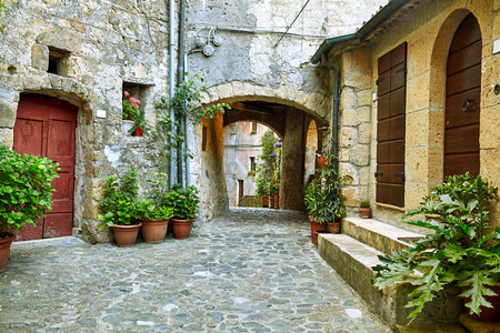 stone age: Lovely colorful streets small town in Tuscany, Italy