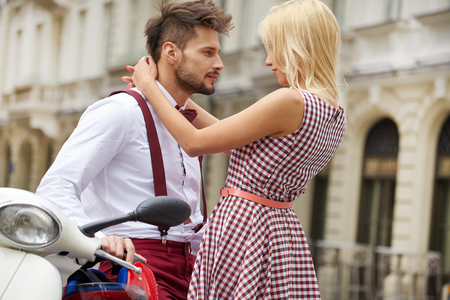 vintage look: Young funny pretty fashion vintage hipster couple having fun outdoor on the street in summer.