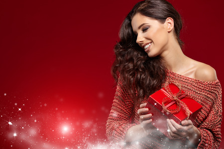 Woman with christmas box gift 스톡 콘텐츠