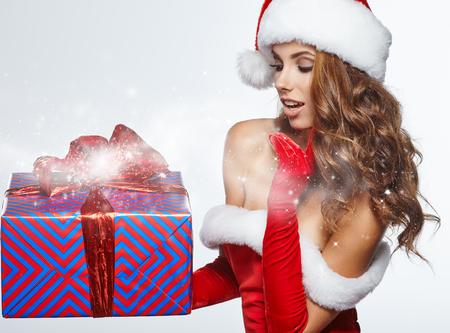 santa helper: Beautiful Santa helper christmas girl with gift