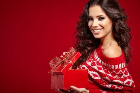 opening gift: beautiful happy woman opening gift box