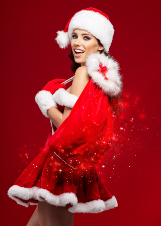 femme brune sexy: beautiful sexy girl wearing santa claus costume