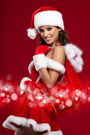 santa claus face: beautiful sexy girl wearing santa claus costume