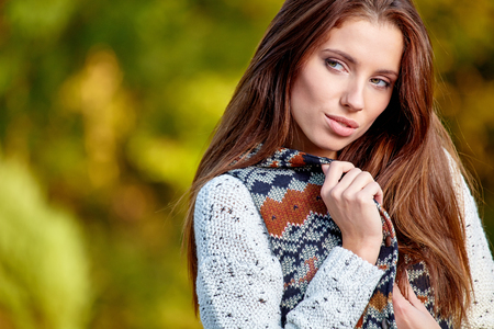 red hair girl: Beautiful  woman standing in a park in autumn