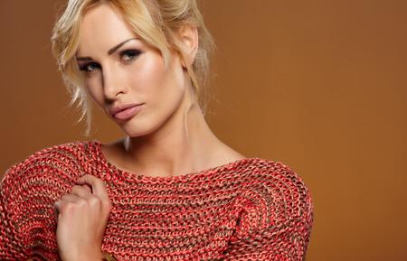 blond girl: Beautiful blonde woman portrait in autumn color. Studio shoot